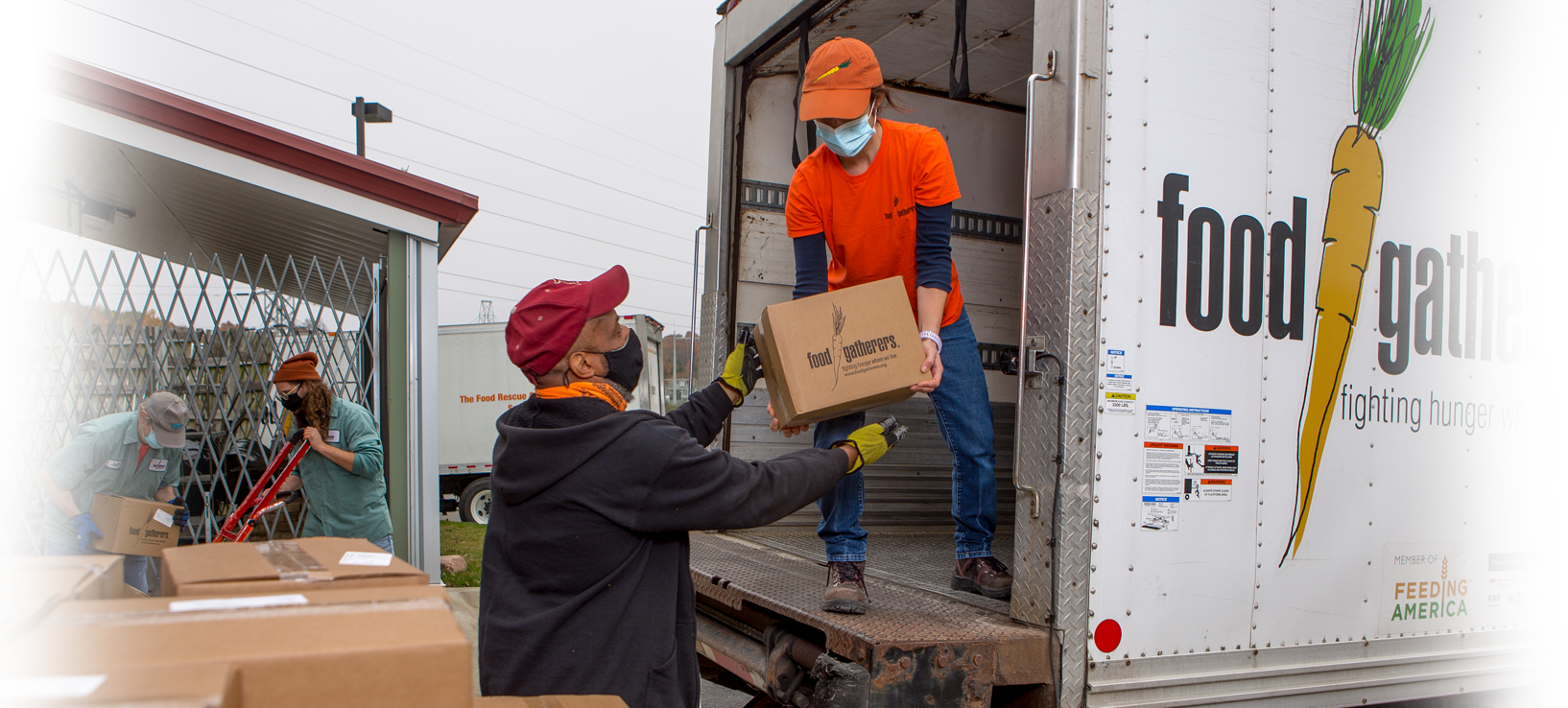 Food Gatherers volunteers help unload a truck